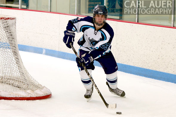 January 11th, 2013: A Ralston Valley hockey player brings the puck around from behind the goal in the game against Battle Mountain at the Apex Ice Arena on Friday night in Arvada, CO