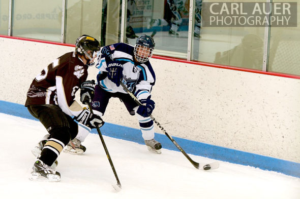 January 11th, 2013: A Ralston Valley hockey player passes the puck past a Battle Mountain player in their game at the Apex Ice Arena on Friday night in Arvada, CO