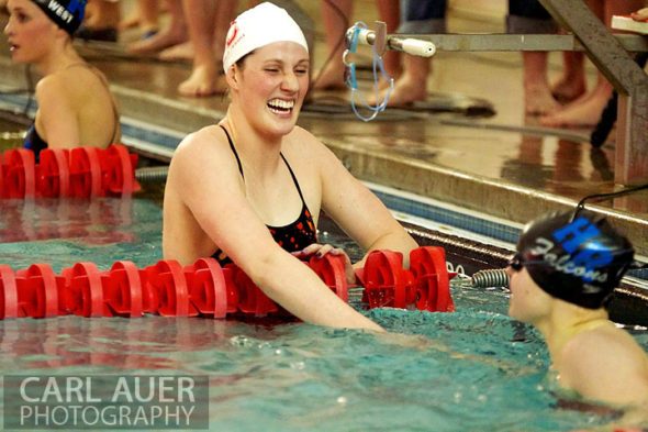 January 8th, 2013: Regis Jesuit High School swimmer and Olympic Gold medalist Missy Franklin congratulates a Highlands Ranch swimmer after one of her 4 heats during the dual meet between Regis Jesuit and Highlands Ranch on Tuesday evening in Aurora, Colorado