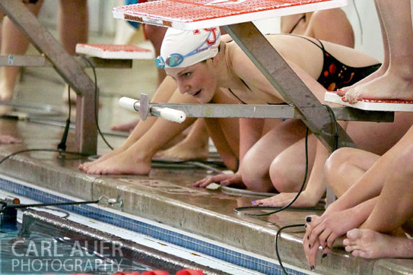 January 8th, 2013: Regis Jesuit High School swimmer and Olympic Gold medalist Missy Franklin cheers a teammate on from the deck in the last of her 4 heats during the dual meet between Regis Jesuit and Highlands Ranch on Tuesday evening in Aurora, Colorado