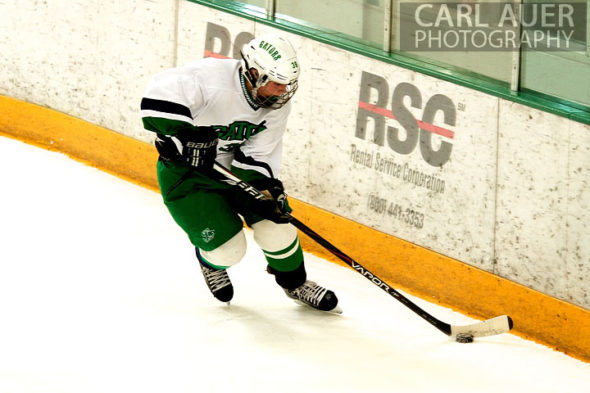 January 4th, 2013: A Standley Lake Gator clears the puck from behind the net in the game against the Columbine Rebels at the Ice Center at the Promenade in Westminster, CO on Friday night.