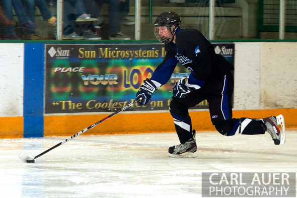 January 4th, 2013: A Columbine Rebel player brings the puck down the ice in the game against the Standley Lake Gators at the Ice Center at the Promenade in Westminster, CO on Friday night.