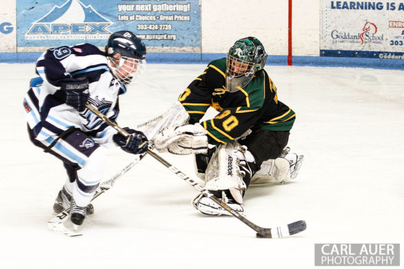 February 22, 2013: Arvada, Colorado - Bishop Machebeuf goalie Alan Rickli attempts to make a stop of a shot by Ralston Valley Mustang junior forward Garrett Schaff in their playoff game at the Apex Center in Arvada