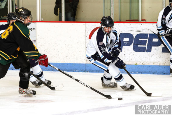 February 22, 2013: Arvada, Colorado - Ralston Valley Mustang junior defender Sam Henry (3) shows off his puck handling against Bishop Machebeuf in their playoff game at the Apex Center in Arvada
