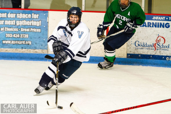 February 22, 2013: Arvada, Colorado - A Valor Christian hockey player with the puck in the game against Standley Lake High School at the Apex Center in Arvada