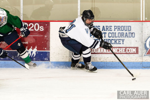 February 22, 2013: Arvada, Colorado - Valor Christian senior forward Ryan Close comes off the boards with the puck in the game against Standley Lake High School at the Apex Center in Arvada