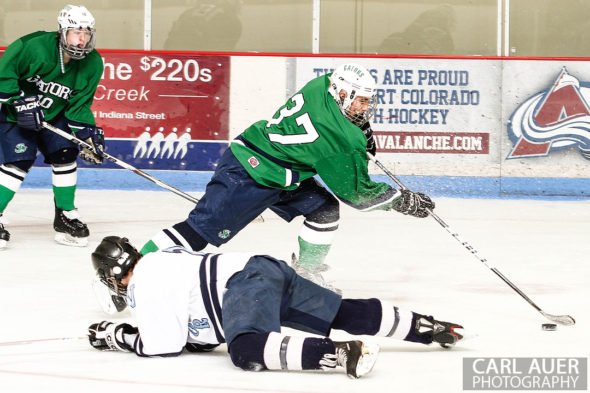February 22, 2013: Arvada, Colorado - Standley Lake Gators forward Ryan Brooks takes the puck past a diving Valor Christian player in the playoff game at the Apex Center in Arvada