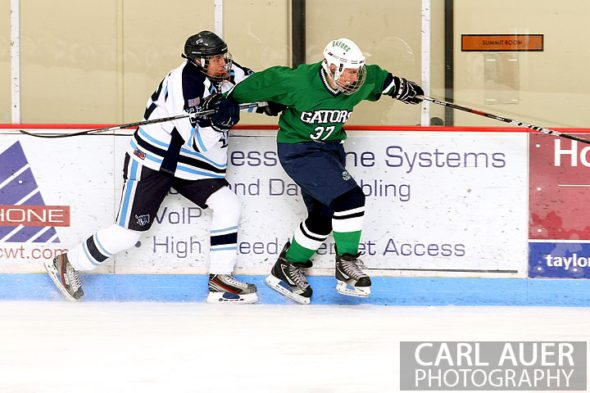 February 6th, 2013: Standley Lake Gators forward Ryan Brooks (37) tries to get away from Ralston Valley Mustang defender Brendan Aleksivich (22) in their game at the Apex Ice Arena in Arvada, Colorado