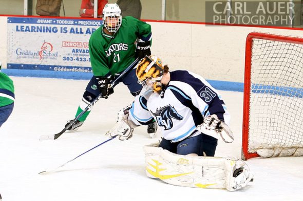 February 6th, 2013: Standley Lake Gators forward Kint Thede (21) watches as Ralston Valley Mustang goalie Zach Larocque (31) in their game at the Apex Ice Arena in Arvada, Colorado
