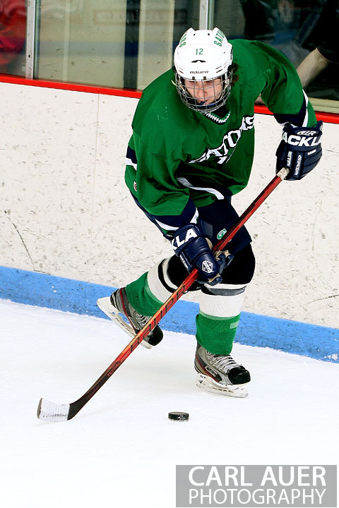 February 6th, 2013: Standley Lake Gators defender Chris Huitt (12) picks up the puck behind the goal in the game against the Ralston Valley Mustangs at the Apex Ice Arena in Arvada, Colorado
