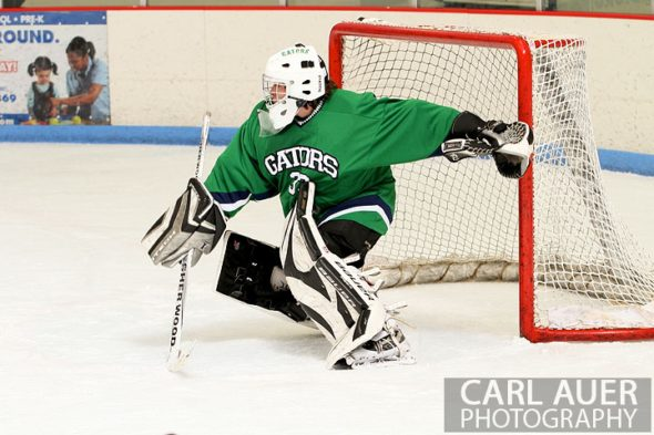 February 6th, 2013: Standley Lake Gators goalie Tyler Goff (33) tries to make a save in the game against the Ralston Valley Mustangs at the Apex Ice Arena in Arvada, Colorado