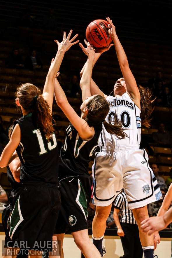 March 14th, 2013:  Pueblo West Cyclones senior Taylor Leyva (00) attempts a shot over the D'Evelyn Jaguars defense in the CHSAA 4A Girls Final Four game against D'Evelyn at the Coors Events Center in Boulder, Colorado