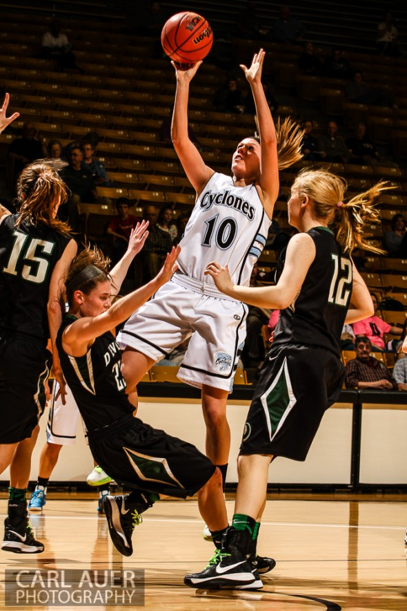 March 14th, 2013:  Pueblo West Cyclones senior Daisy Romero (10) attempts a shot over the D'Evelyn Jaguars defense in the CHSAA 4A Girls Final Four game against D'Evelyn at the Coors Events Center in Boulder, Colorado
