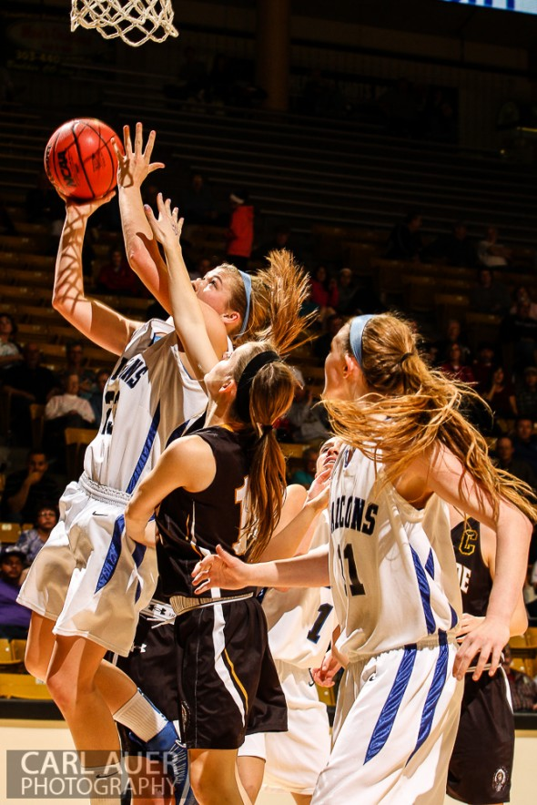 March 14th, 2013:  Highlands Ranch Falcons senior Shelby Hickey (23) attempts a baseline lay up in the CHSAA 5A Girls Final Four game against the Arapahoe Warriors at the Coors Events Center in Boulder, Colorado