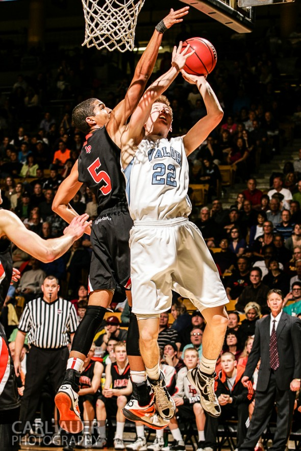 March 16th, 2013: Valor Christian Eagles junior forward Chase Foster (22) attempts to get a shot past the defense of Lewis-Palmer Rangers senior guard/forward Jordan Scott (5) in the CHSAA 4A State Championship game at the Coors Events Center in Boulder, Colorado