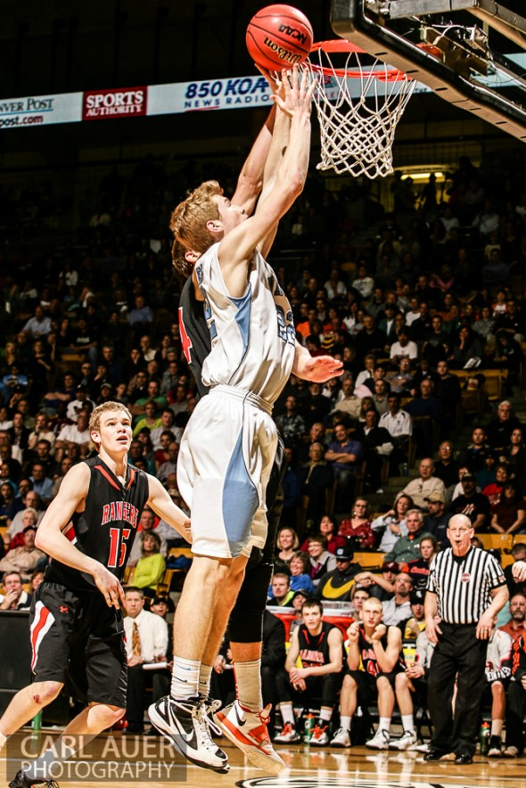 March 16th, 2013: Valor Christian Eagles junior forward Chase Foster (22) attempts a shot past the Lewis-Palmer Rangers defense in the CHSAA 4A State Championship game at the Coors Events Center in Boulder, Colorado