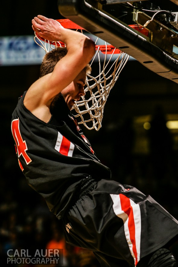 March 16th, 2013:  Lewis-Palmer Rangers senior guard/forward Justin Smith (24) hangs on the rim after he slam dunked the ball in the CHSAA 4A State Championship game against the Valor Christian Eagles at the Coors Events Center in Boulder, Colorado
