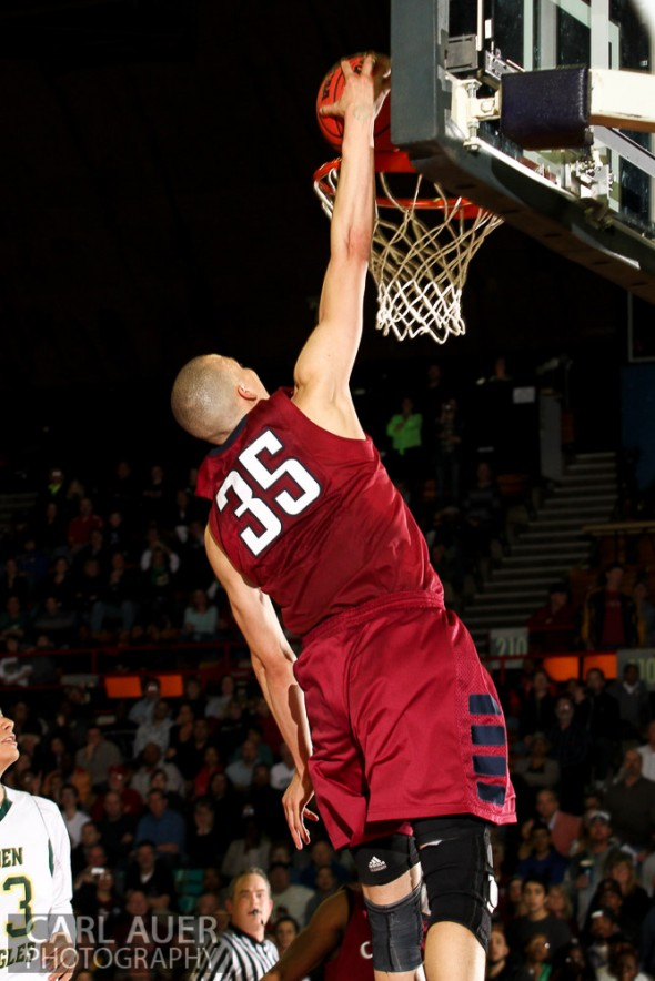 Cherokee Trail senior forward/center Dirk Bernstine attempts a dunk in overtime of the 5A Great 8 CHSAA State Tournament game against Mountain Vista