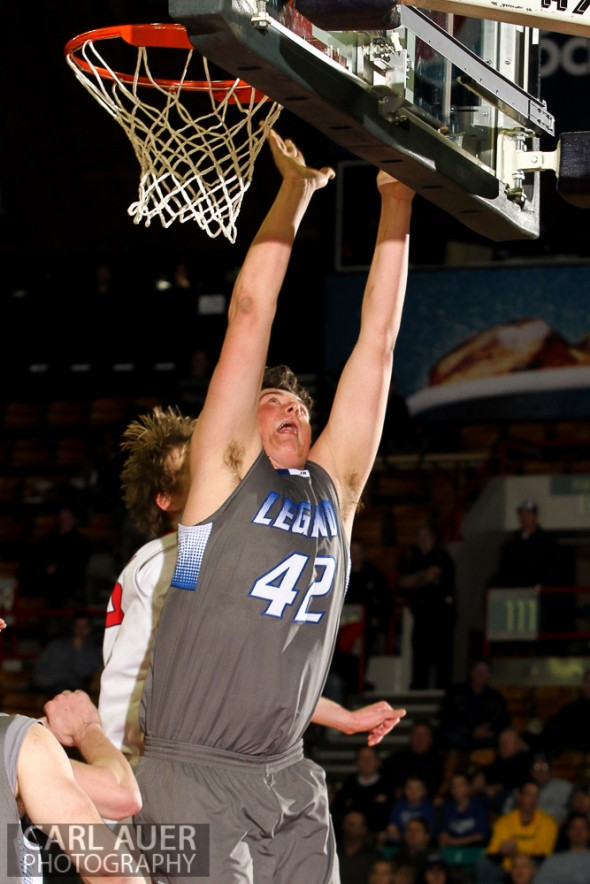 Zach Mihalicz, junior center for Legend High School, attempts a lay up in the CHSAA 5A Great 8 game between Legend and Fairview at the Denver Coliseum