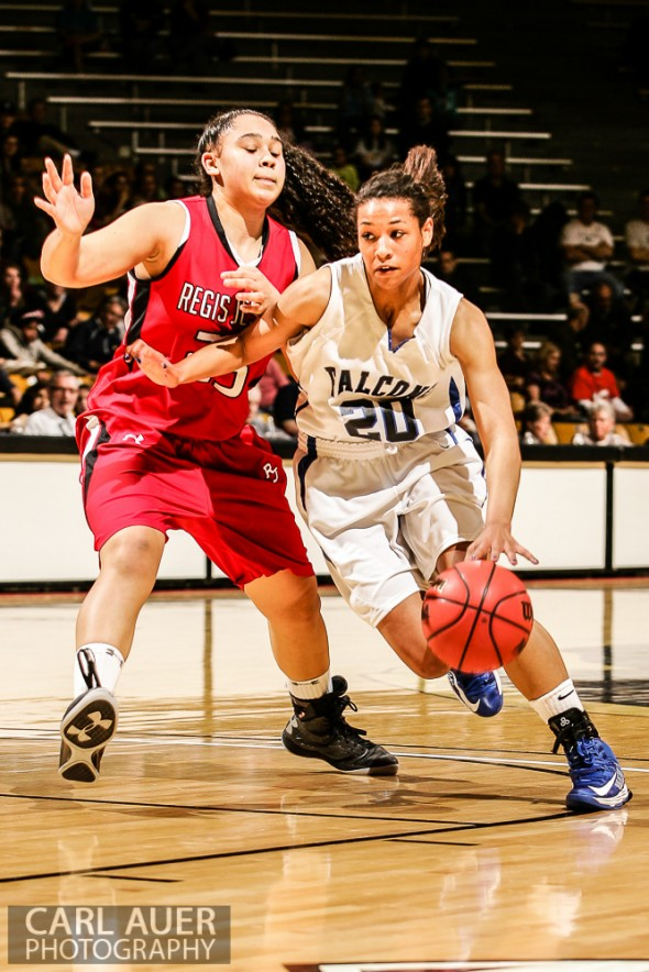 March 16th, 2013:  Highlands Ranch Falcons junior guard Ciera Morgan (20) attempts to drive past Regis Jesuit Raiders junior forward Kelsi Lidge (25) in the CHSAA 5A State Championship Final Game at the Coors Events Center in Boulder, Colorado