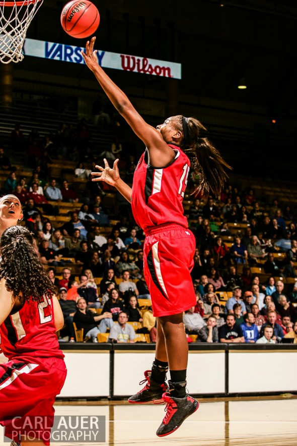 March 16th, 2013:  Regis Jesuit Raiders junior forward/center Diani Akigbogun (15) finds herself wide open for a shot attempt  in the CHSAA 5A State Championship Final Game against the Highlands Ranch Falcons at the Coors Events Center in Boulder, Colorado
