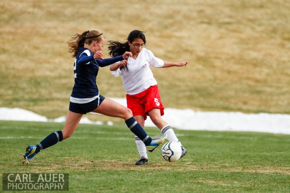 April 11, 2013: The Evergreen Cougars girls soccer team won Thursday's away conference game against Arvada by a score of 10-0.