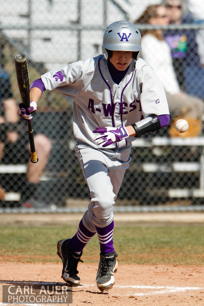 April 24th, 2013: A Arvada West player attempts to reach 1st base on a bunt in the Wildcats game against the Ralston Valley Mustangs at Ralston Valley High School in Arvada, Colorado