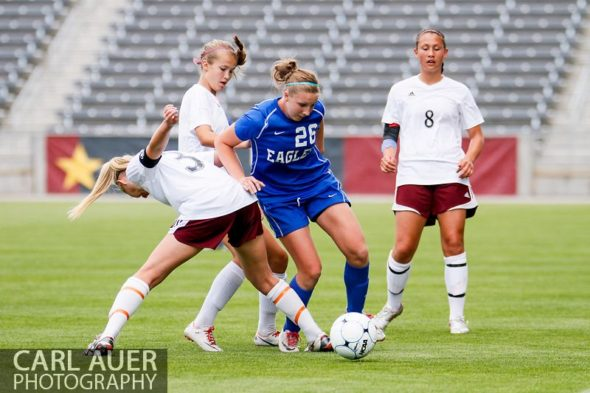 May 22, 2013 - A Broomfield Eagles player attempts to maintain control of the ball as she is surrounded by Cheyenne Mountain Indians in the CHSAA 4A Girls Soccer Championship Game at Dick's Sporting Goods Park in Commerce City, Colorado
