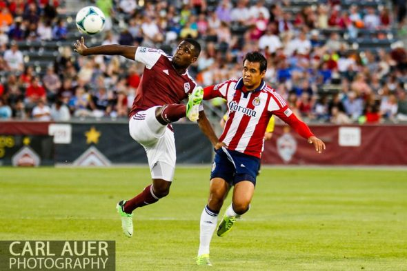May 25th, 2013 - Colorado Rapids forward Edson Buddle (9) attempts to collect a pass as he grabs the shorts of Chivas USA defender Mario de Luna (3) in the first half of action in the MLS match between Chivas USA and the Colorado Rapids at Dick's Sporting Goods Park in Commerce City, CO