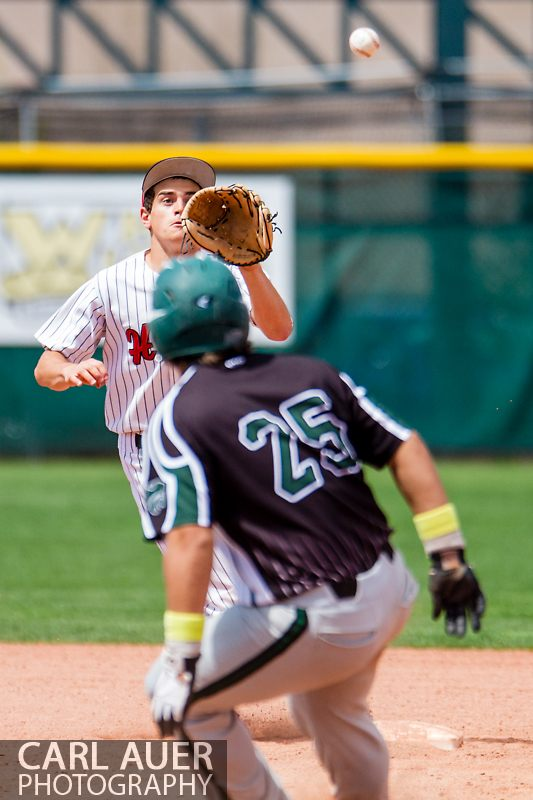 May 17th 2013: Fleming Wildcats senior Trevor Chintala (25) gets caught in a run down during the CHSAA 1A Baseball final against the Holly Wildcats at All Star Park in Lakewood, Colorado