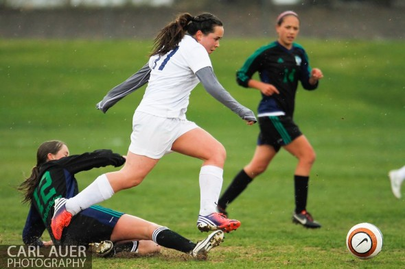 May 8th, 2013: Ralston Valley Mustang junior Brenna Marinez (17) jumps over the downed ThunderRidge Grizzlies freshman Erin Speer (12) in the CHSAA 5A Soccer Playoff game at the North Area Athletic Complex in Arvada, Colorado
