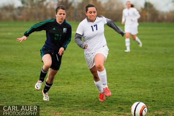 May 8th, 2013: Ralston Valley Mustang junior Brenna Marinez (17) and ThunderRidge Grizzlies freshman Sanela Hodzic (21) chase after the ball in the CHSAA 5A Soccer Playoff game at the North Area Athletic Complex in Arvada, Colorado