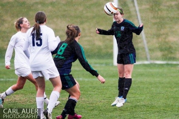 May 8th, 2013: ThunderRidge Grizzlies sophomore Grace Hoffman (16) heads the ball in the CHSAA 5A Soccer Playoff game against Ralston Valley at the North Area Athletic Complex in Arvada, Colorado