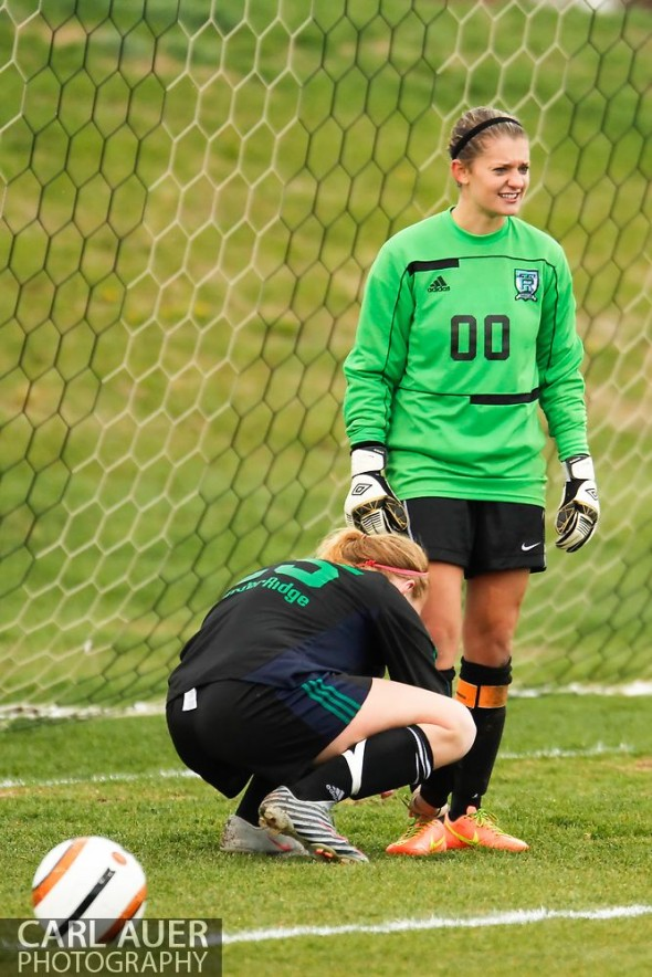 May 8th, 2013: ThunderRidge Grizzlies senior goalkeeper Kristen Rossi (00) needs help tying her shoes from senior Maddie Shelton (25) in the CHSAA 5A Soccer Playoff game against Ralston Valley at the North Area Athletic Complex in Arvada, Colorado