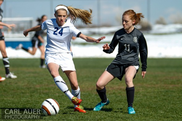 May 2nd, 2013: Ralston Valley Mustang freshman midfielder Alyssa Kaiser (24) attempts to get around D'Evelyn Jaguars senior Kerry Carmody in the game at the North Area Athletic Complex in Arvada, Colorado