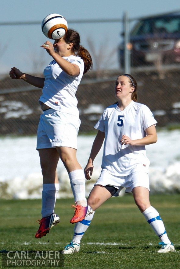May 2nd, 2013: Ralston Valley Mustang junior midfielder Maddie Allensworth (5) watches as teammate Brenna Marinez (17), a junior midfielder/defender heads the ball in the game against the D'Evelyn Jaguars at the North Area Athletic Complex in Arvada, Colorado