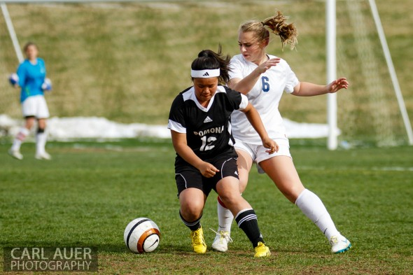 May 3rd, 2013: A Pomona Panthers players attempts to keep the ball away from Ralston Valley Mustangs junior defender Taylor Lawerence (6) in the game at the North Area Athletic Complex in Arvada, Colorado