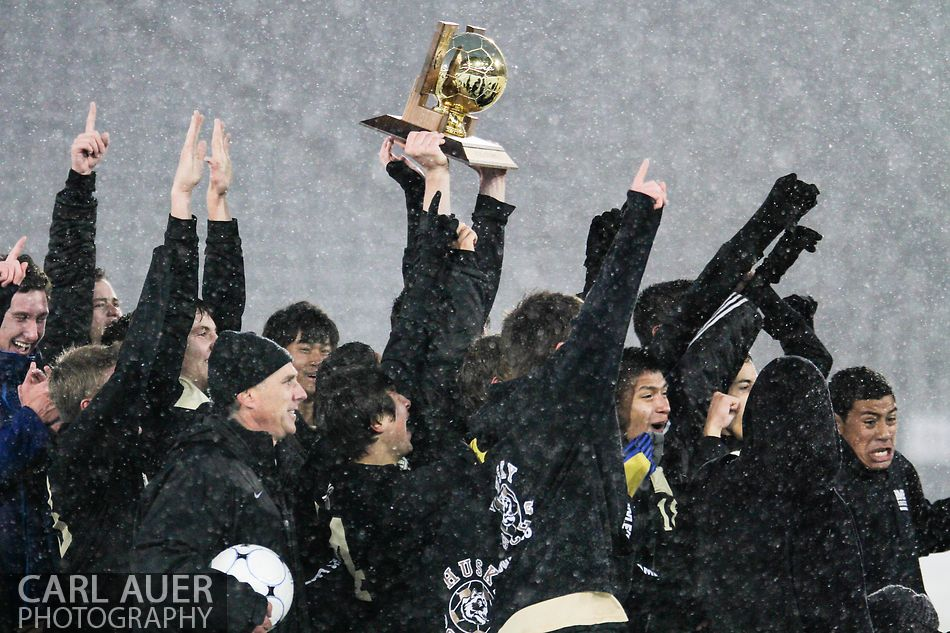 November 10, 2012: The Battle Mountain Huskies hoist the Colorado Boys 4A State Championship Soccer trophy over their heads in a snow storm at Dick's Sporting Goods Park