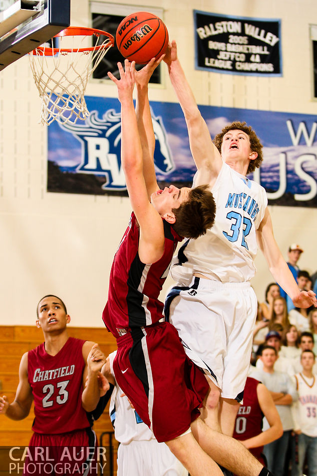 January 25, 2013 - Ralston Valley Mustang Jonathan Gillespie (32) blocks the shot attempt by Chatfield's Alec Wray in the conference game at Ralston Valley High School.