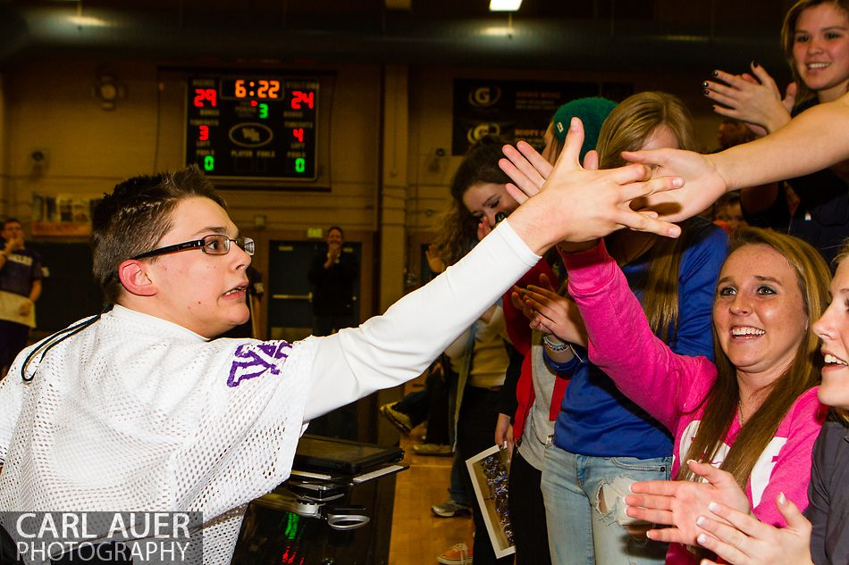 February 15, 2013 - Wheat Ridge High School Junior Chris Reiman (white jersey) gives high fives to his classmates after the Arvada West Sparkles first performance at his high school.