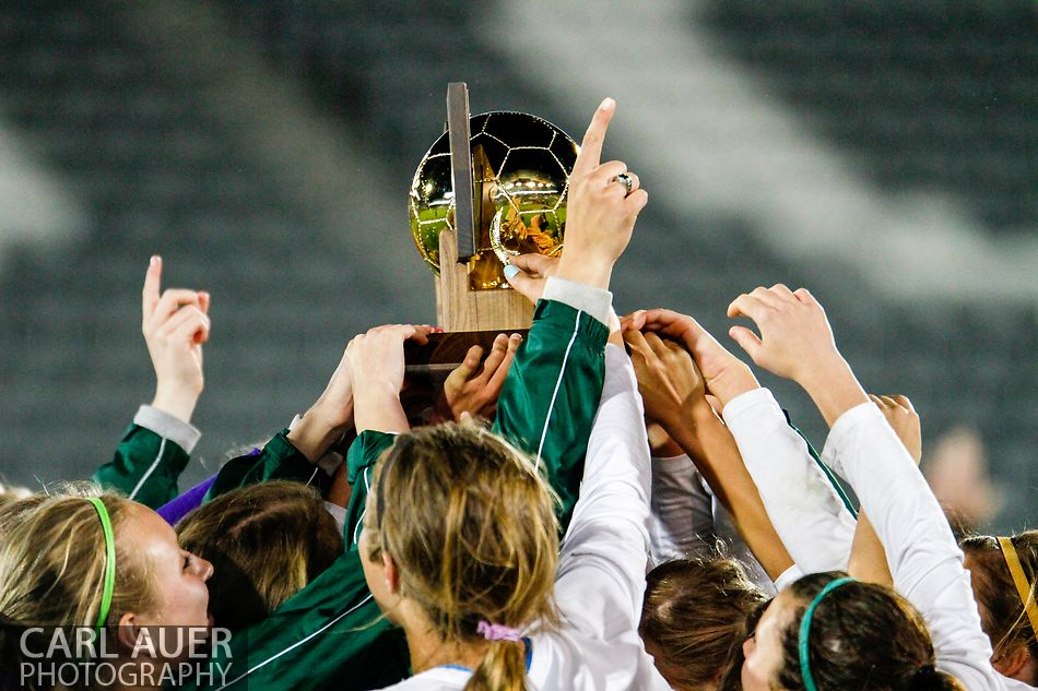 May 22, 2013 – The Mountain Vista Golden Eagles raise the Colorado 5A State Championship trophy over their heads after defeating the Rock Canyon Jaguars 1-0 in overtime at Dick's Sporting Goods Park in Commerce City, CO