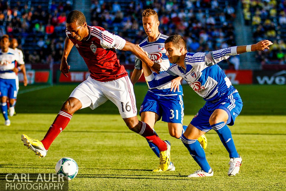 June 1st, 2013 – Colorado Rapids midfielder Atiba Harris (16) attempts to get the ball past FC Dallas midfielder Andrew Jacobson (4) and defender/midfielder Michel (31) in the first half of action in the MLS match between FC Dallas and the Colorado Rapids at Dick's Sporting Goods Park in Commerce City, CO