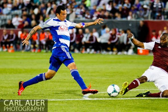 June 1st, 2013 - Colorado Rapids defender Marvell Wynne (22) slides in to break up a shot attempt by FC Dallas forward Blas Pérez (7) in the second half of action in the MLS match between FC Dallas and the Colorado Rapids at Dick's Sporting Goods Park in Commerce City, CO
