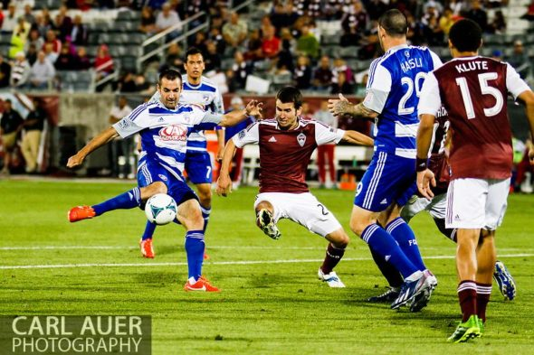 June 1st, 2013 - Colorado Rapids midfielder Nathan Sturgis (24) attempts to break up a shot attempt by FC Dallas midfielder Andrew Jacobson (4) in second half action of the MLS match between FC Dallas and the Colorado Rapids at Dick's Sporting Goods Park in Commerce City, CO