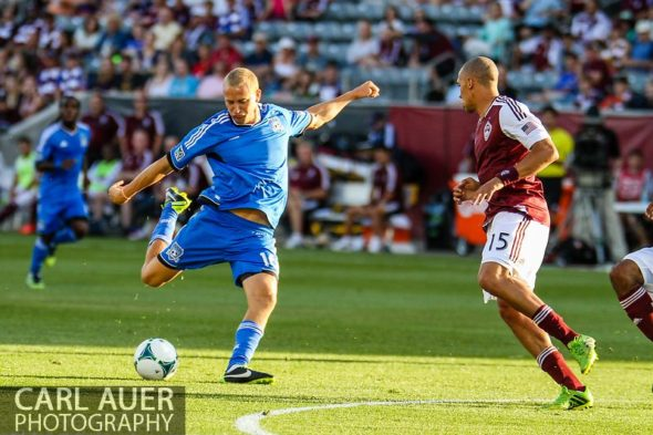 June 15th, 2013 - San Jose Earthquake forward Steven Lenhart (16) winds-up for a shot past Colorado Rapids defender Chris Klute (15) resulting in the games first goal in the first half of the MLS match between San Jose Earthquake and the Colorado Rapids at Dick's Sporting Goods Park in Commerce City, CO