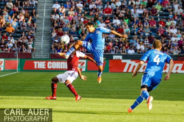 June 15th, 2013 - San Jose Earthquake defender Steven Beitashour (33) goes airborne to kick the ball away from Colorado Rapids defender/midfielder Anthony Wallace (6) during the first half of action in the MLS match between San Jose Earthquake and the Colorado Rapids at Dick's Sporting Goods Park in Commerce City, CO