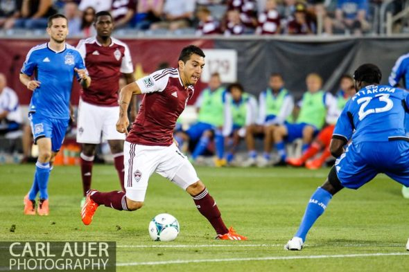 June 15th, 2013 - Colorado Rapids midfielder Martin Rivero (10) attempts to dribble the ball past the San Jose defense in the second half of the MLS match between San Jose Earthquake and the Colorado Rapids at Dick's Sporting Goods Park in Commerce City, CO