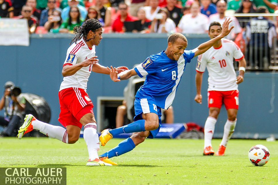 July 14 2013:  Martinique Defender Audrick Linord (8) attempts to keep the ball away from Mexico Midfield Carlos Peña (6) in the first half of the CONCACAF Gold Cup soccer match between Martinique and Mexico at Sports Authority Field in Denver, CO. USA.