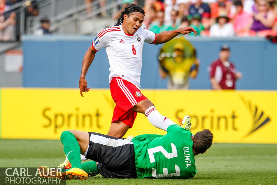 July 14 2013:  Mexico Midfield Carlos Peña (6) attempts to get a shot past Martinique Goalie Kevin Olimpa (23) in second half action of the CONCACAF Gold Cup soccer match between Martinique and Mexico at Sports Authority Field in Denver, CO. USA.