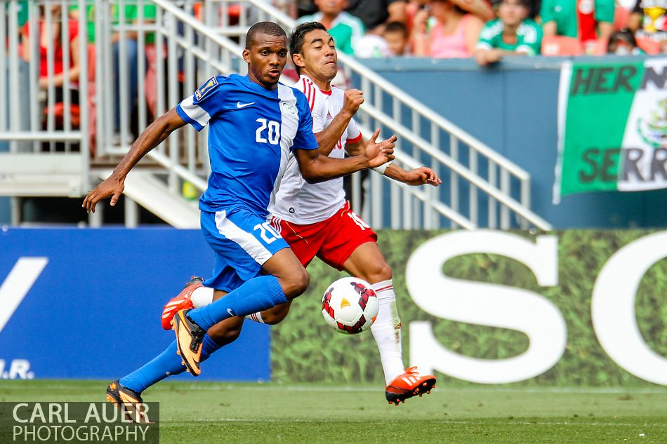 July 14 2013:  Both Martinique Midfield Stephane Abaul (20) and Mexico Forward Marco Fabian (10) chase after the ball during second half action of the CONCACAF Gold Cup soccer match between Martinique and Mexico at Sports Authority Field in Denver, CO. USA.